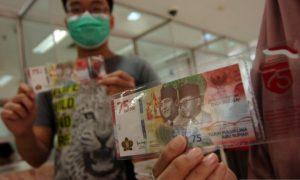 antarafoto-penukaran-uang-baru-pecahan-rp-75.000-180820-ol-6.jpg